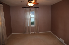 The master bedroom, which has sort of a pearlized mauve paint right now. Every room is getting new paint.