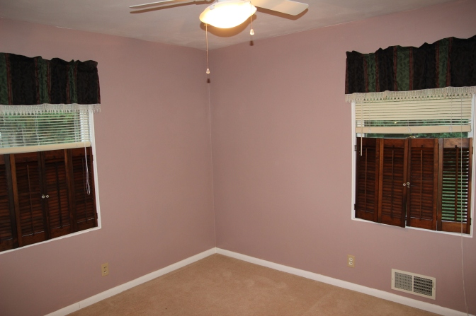 The boys' room, which has an excessive number of window treatments going on